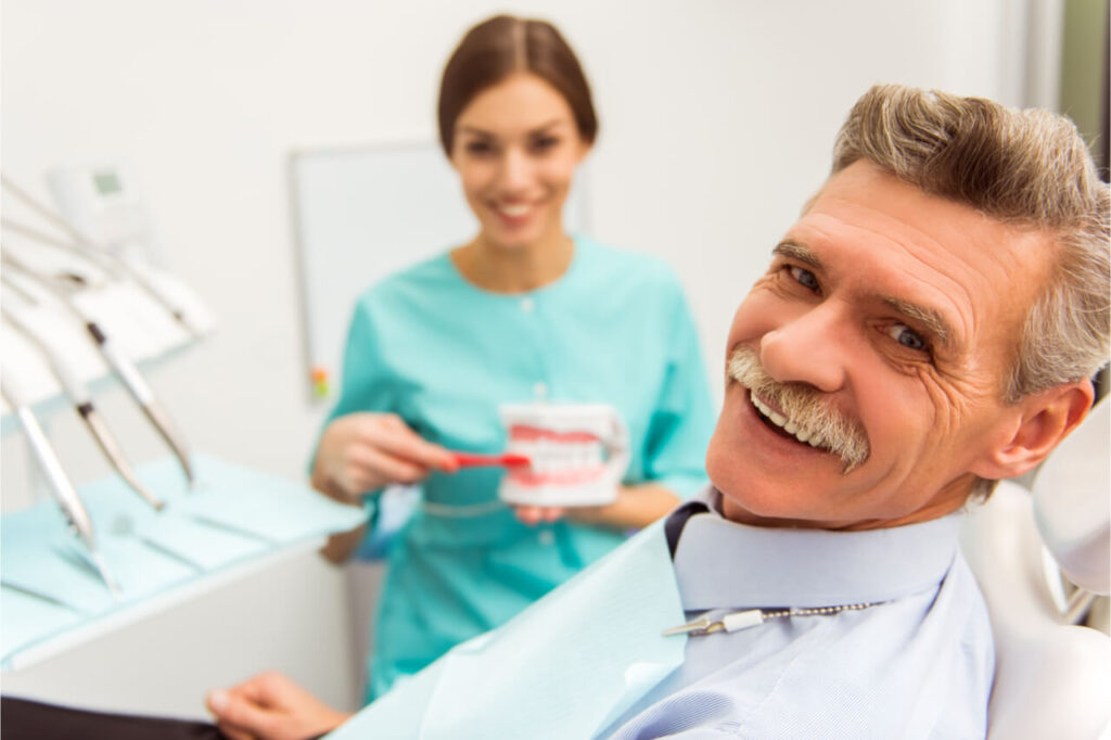 The elderly patient smiles at the camera.