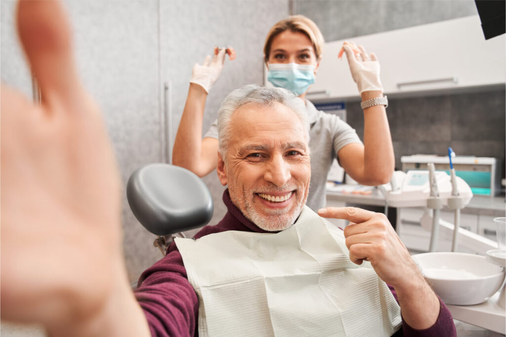The patient is excited to get dental treatment.