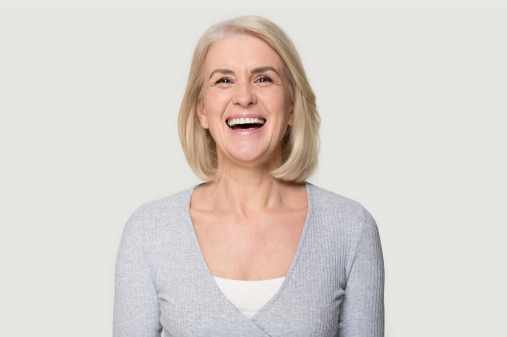 The woman has a healthy smile.