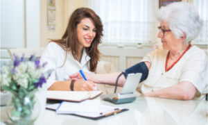The personal helper of the older woman is a skilled nurse.