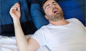 snoring man while asleep