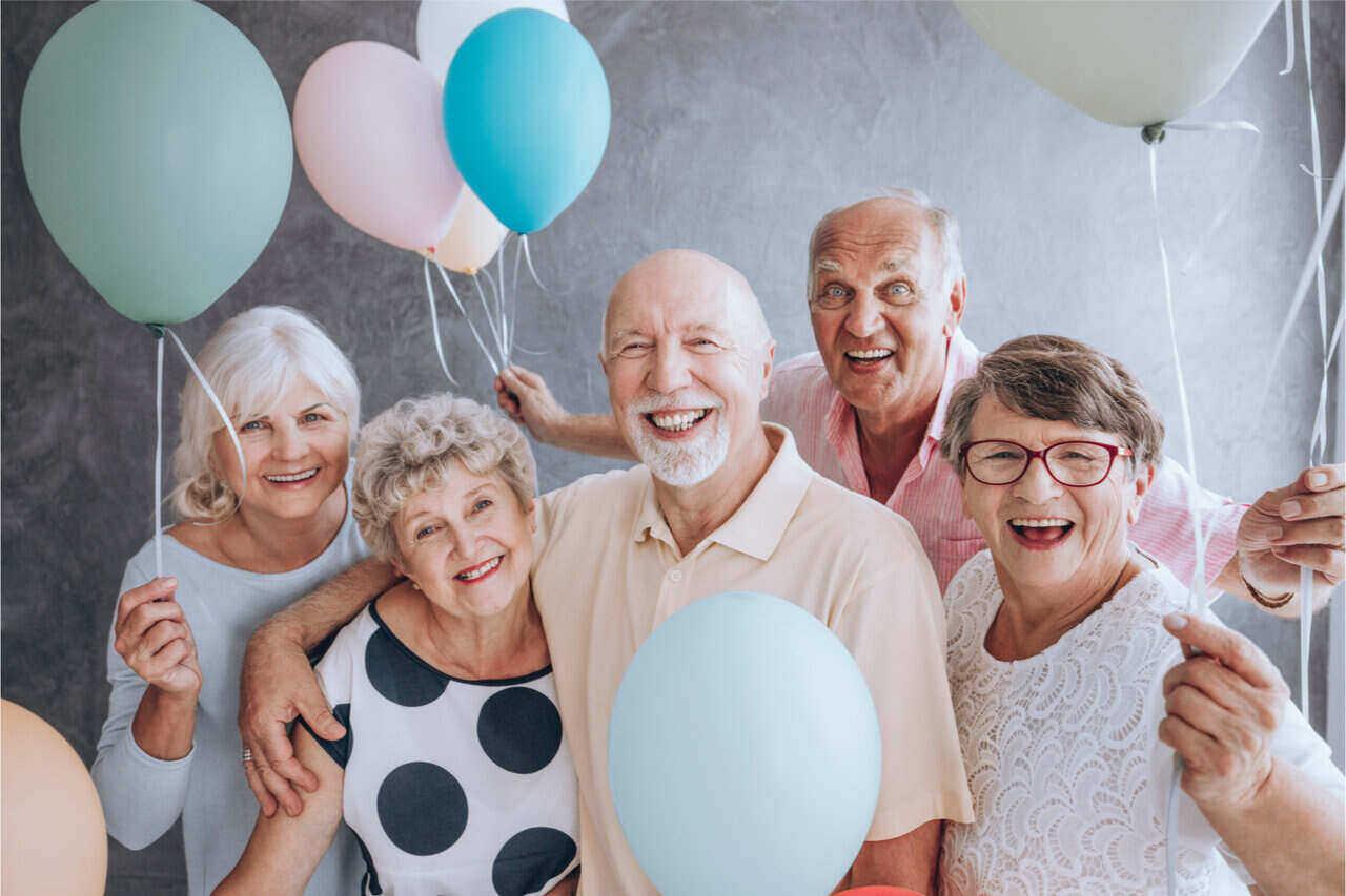 Elders all smiles after dental implants cost full mouth restoration.